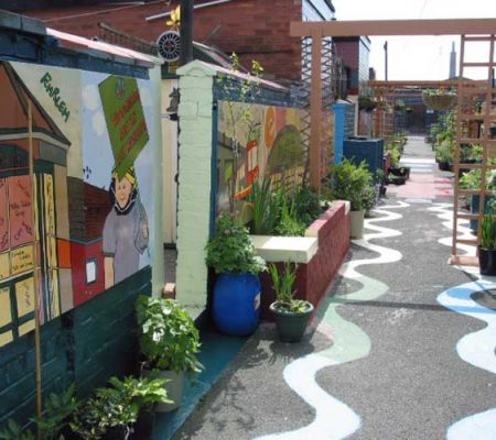 Mural painting - Manchester City Council developing shared community spaces.