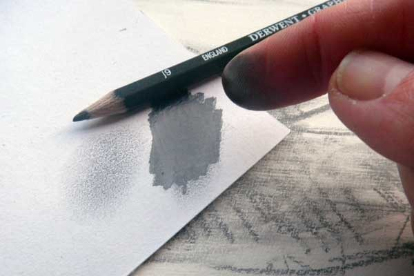 Use graphite from your fingers to blend and create soft tones when drawing