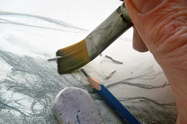 Use a brush to wipe excess pencil graphite or eraser bits off your drawings